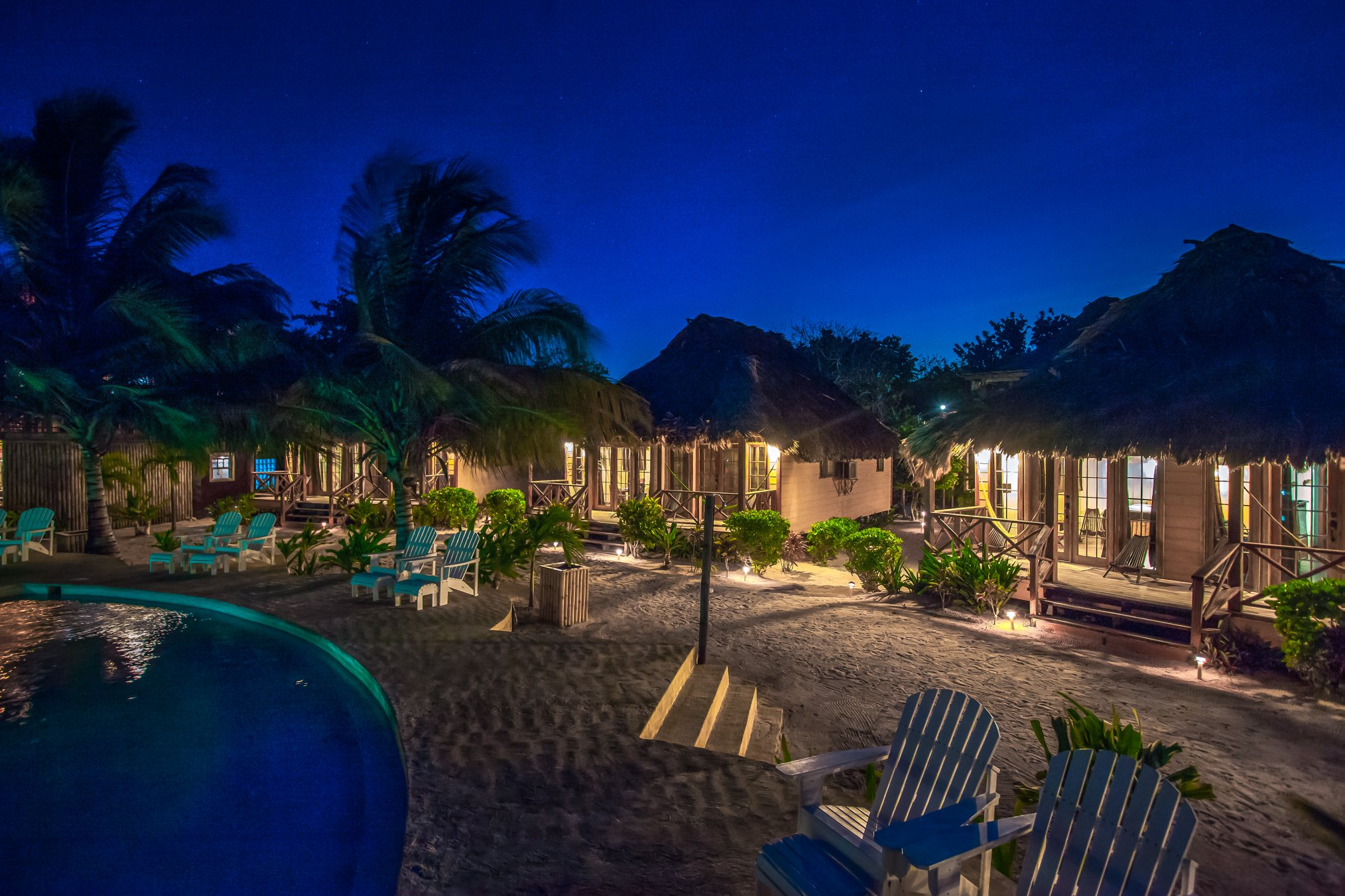 Sleep underneath a palapa roof at Portofino Beach Resort in Belize